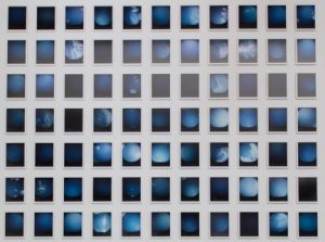A 7 x 11 grid of small rectangles with images of the sky in varying shades of blue on a white background.