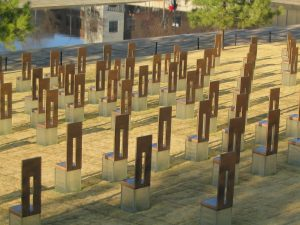 Sculptures of chairs stand in a field to form a memorial at the Oklahoma City Bombing Memorial
