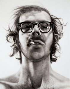 Chuck Close self portrait, depicting Close with glasses and a cigarette.