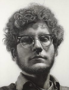 Chuck Close portrait, depicting a man with glasses and curly hair.