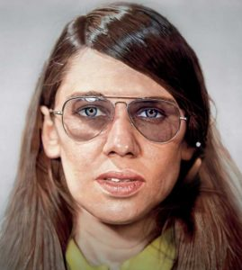 Chuck Close portrait, depicting a woman with aviator glasses.