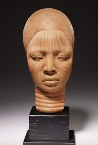 Nigerian sculpture, which depicts a woman's head and neck.